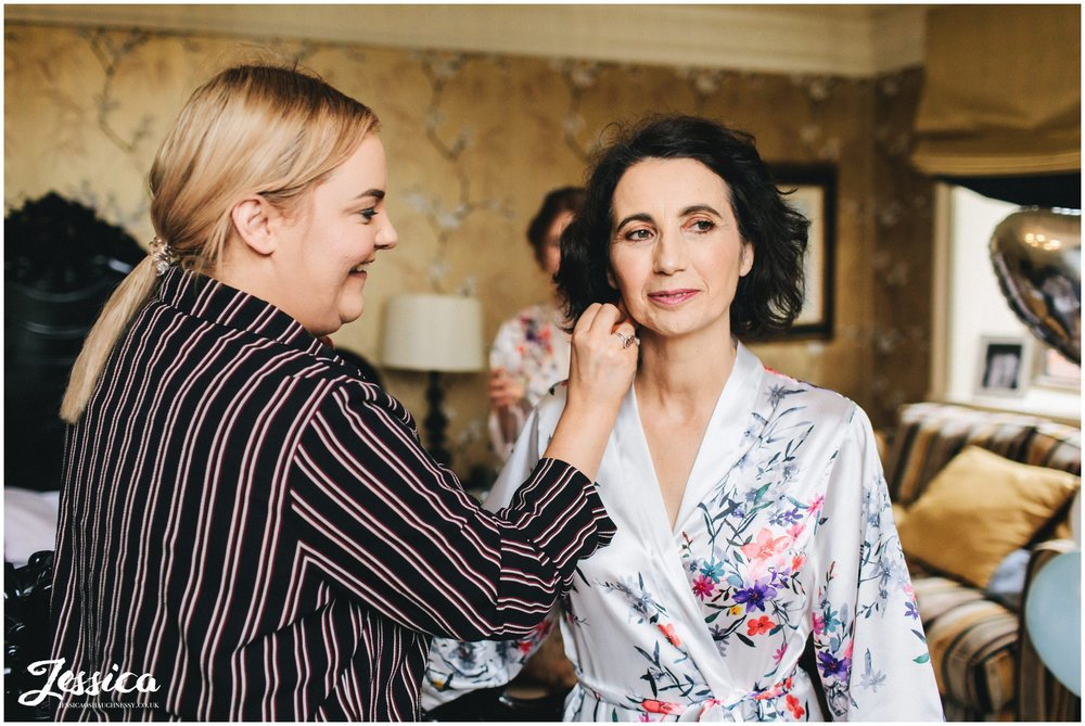 mother of the bride gets her make up done