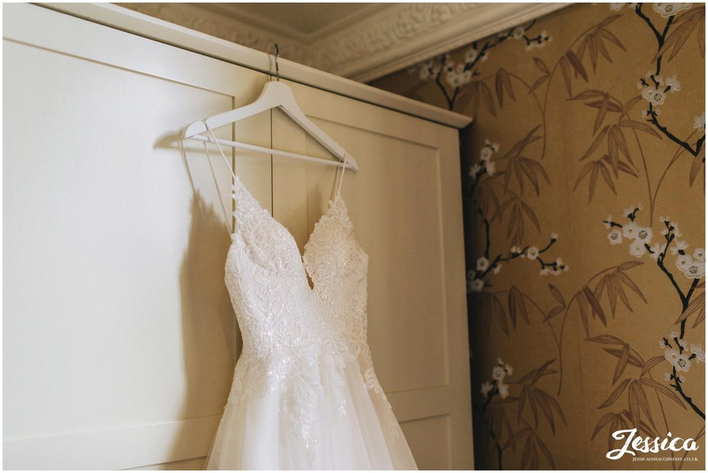 Bride's dress hanging on the wardrobe