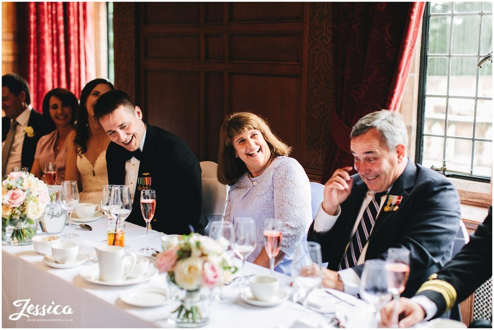 mother of the groom enjoys the speeches in inglewood manor