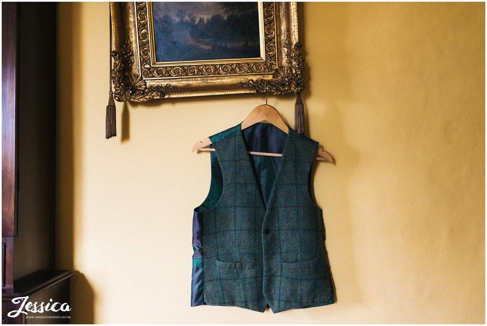 tweed waistcoat hangs ready for the groom