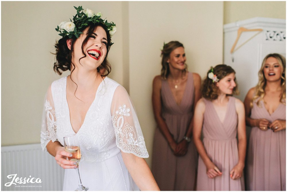 bride laughs on the morning of her chester wedding