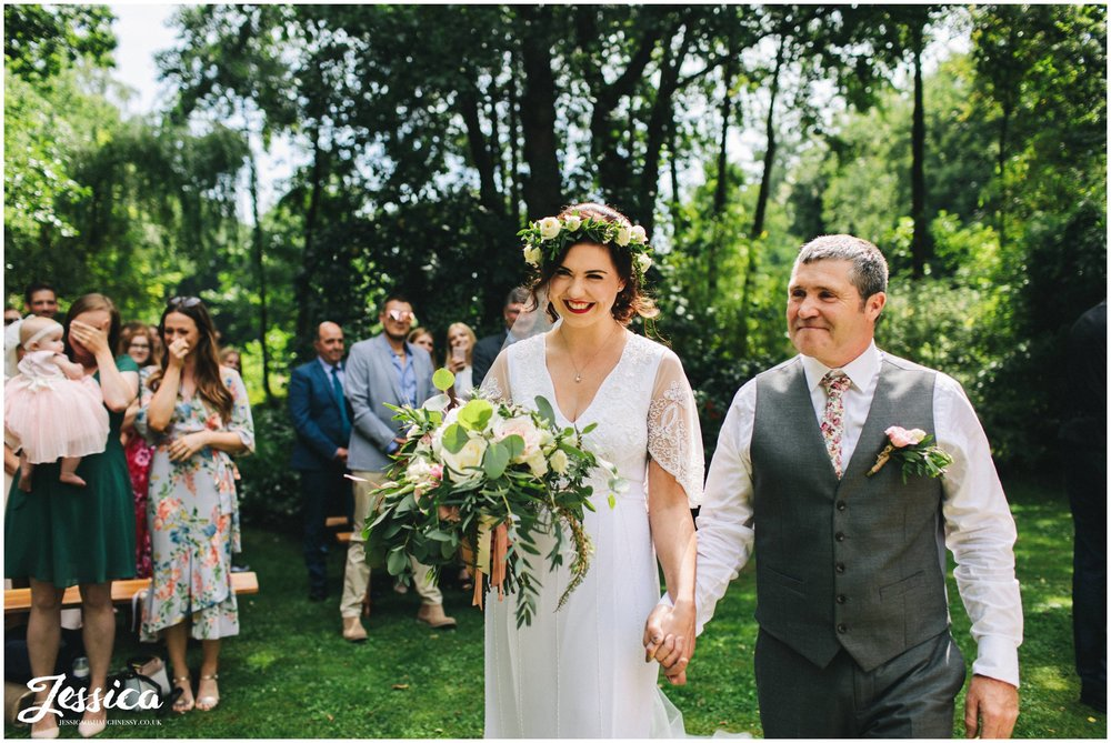 an outdoor ceremony at stonyford cottage gardens in the woodland