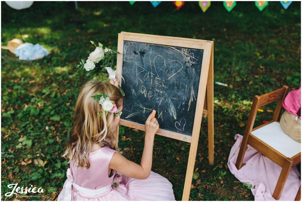 flower writes the couples name on the blackboard