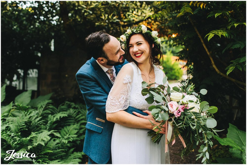 couple embrace in stonyford cottage gardens