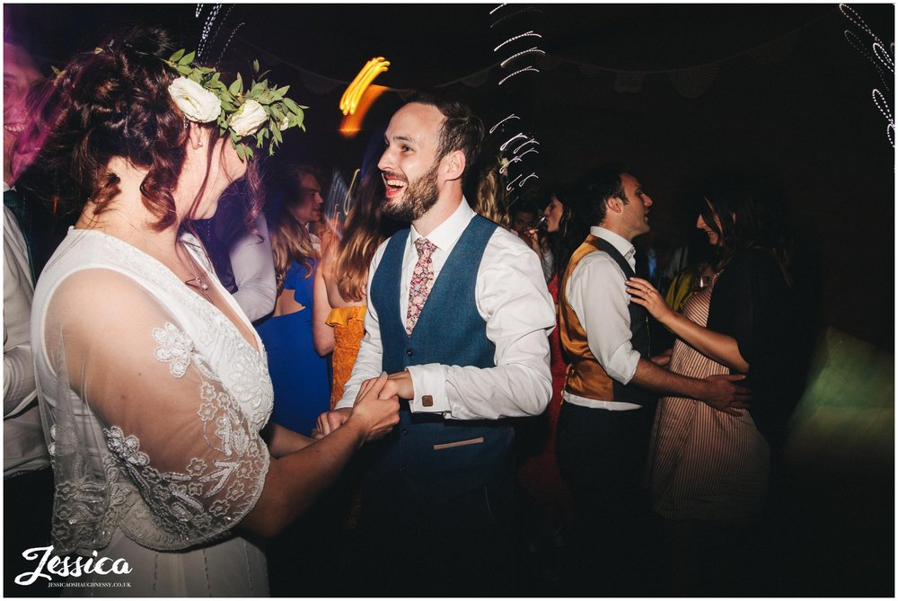 bride & groom dance  on the dancefloor at stonyford cottage gardens
