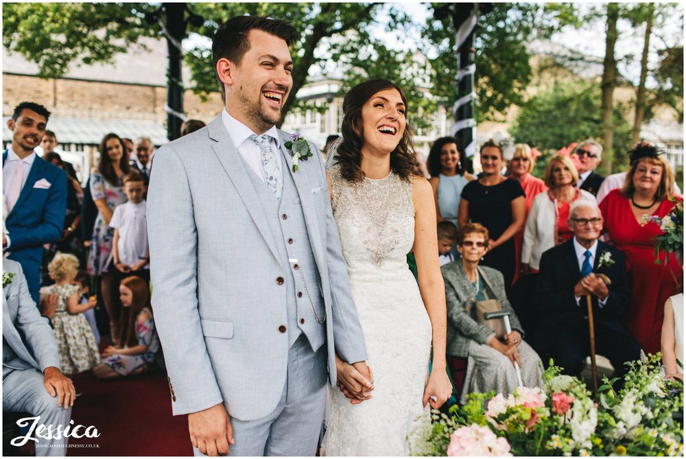 couple laugh during their wedding ceremony in derbyshire