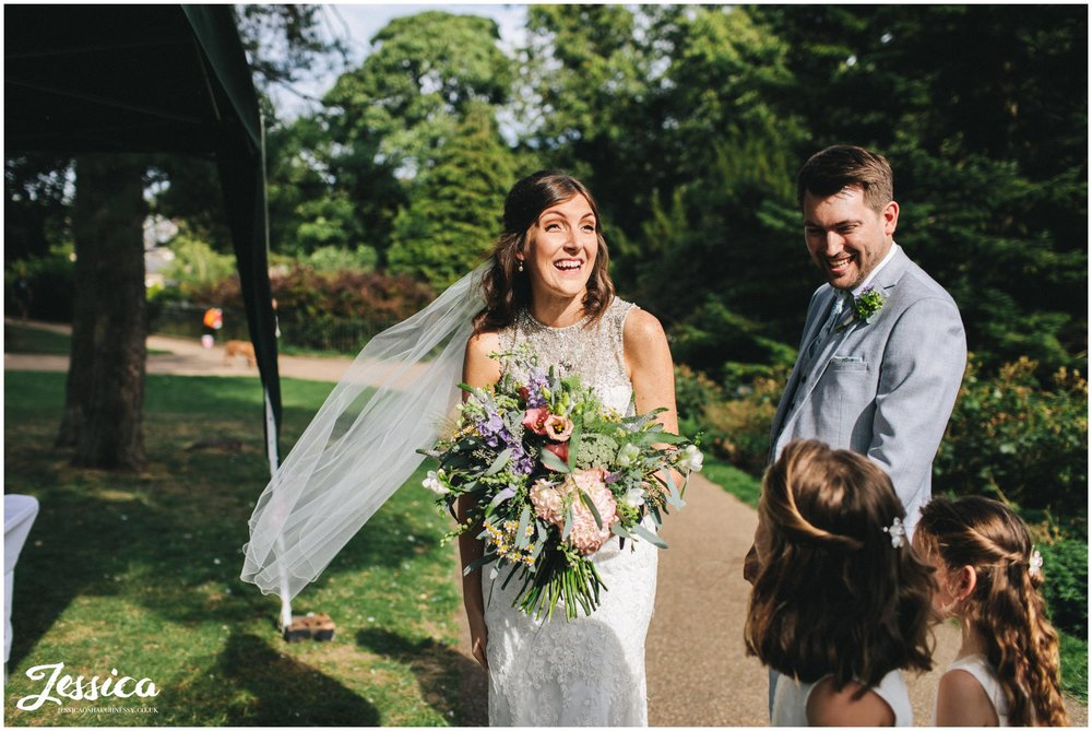 bride laughs excitedly at buxton pavilion gardens