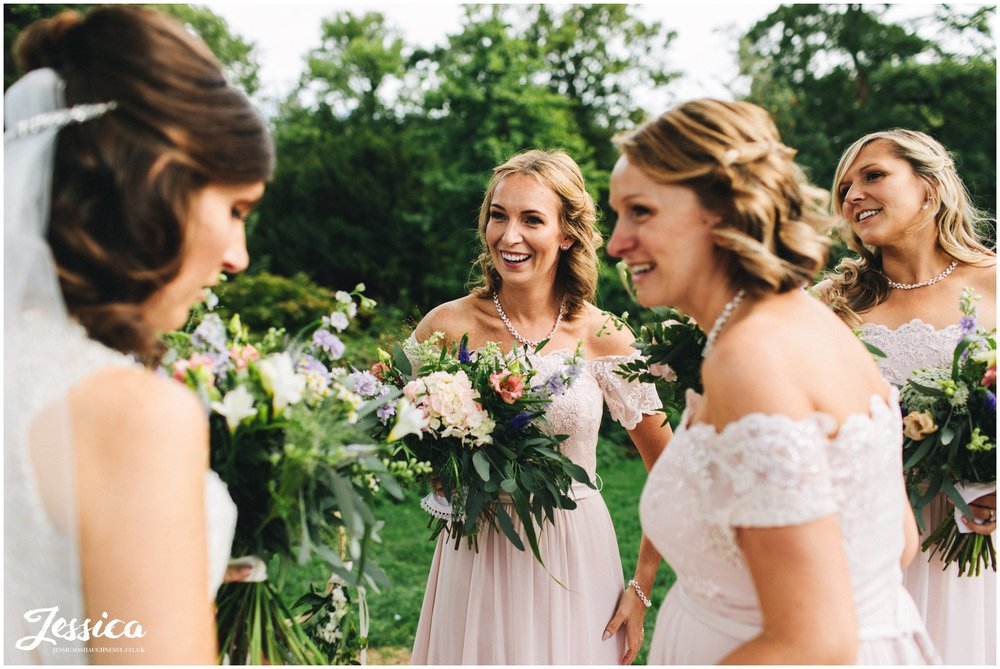 bridesmaids congratulate the new bride