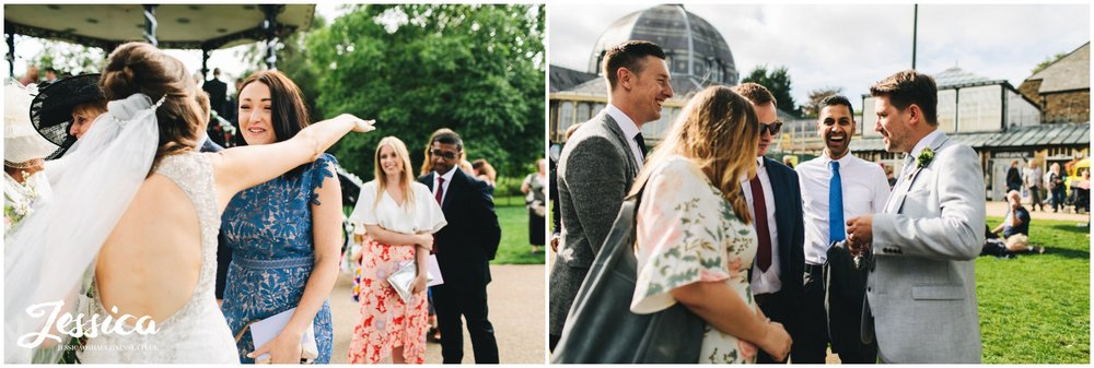 guests enjoy the outdoor wedding reception at buxton pavilion gardens
