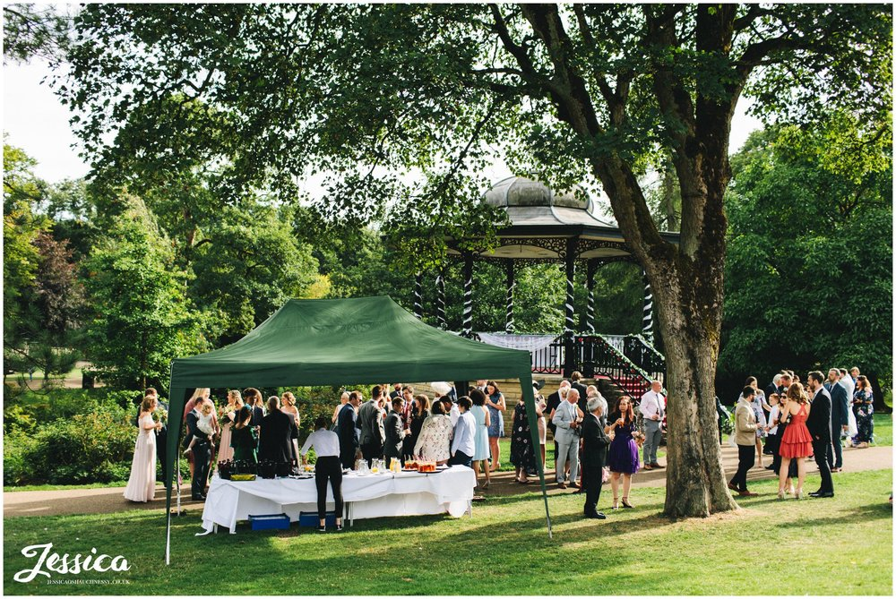guests enjoy reception drinks in buxton pavilion gardens
