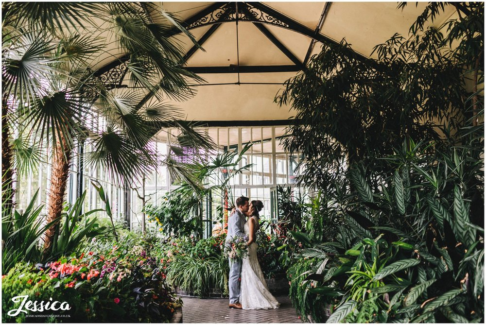 newly wed's kiss in the greenhouse at buxton pavilion gardens