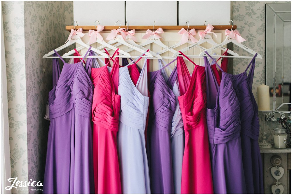 bridesmaids dresses hung on the wardrobe