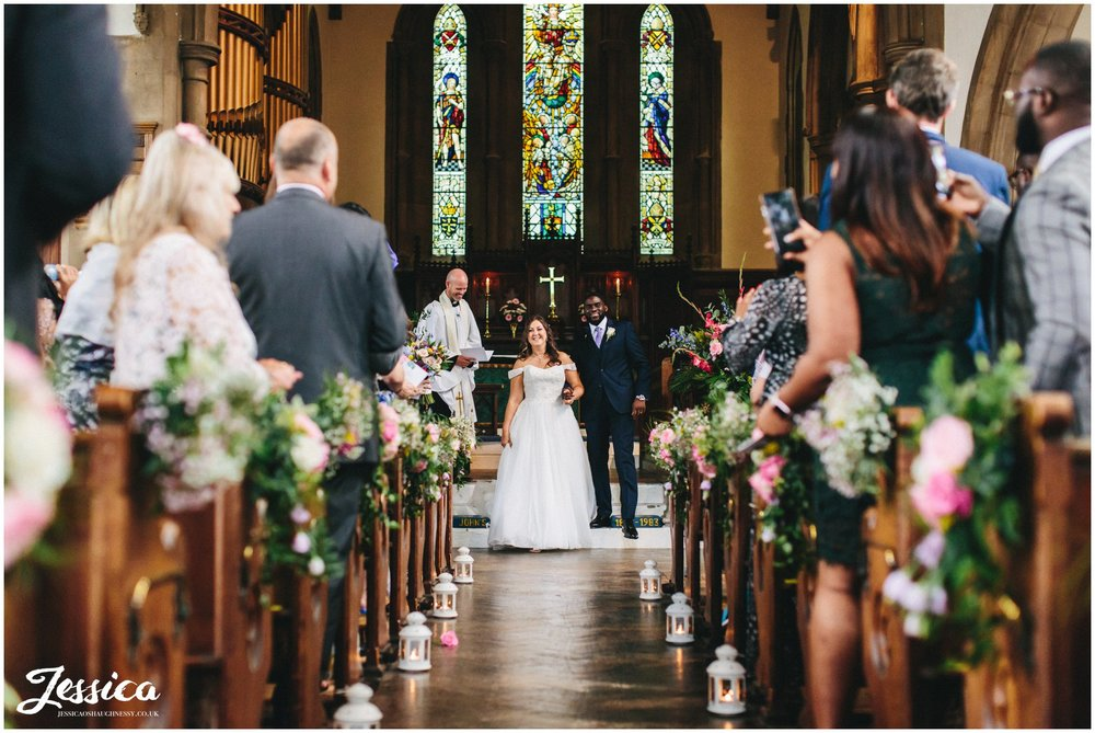 the couple walk out of the church as husband and wife