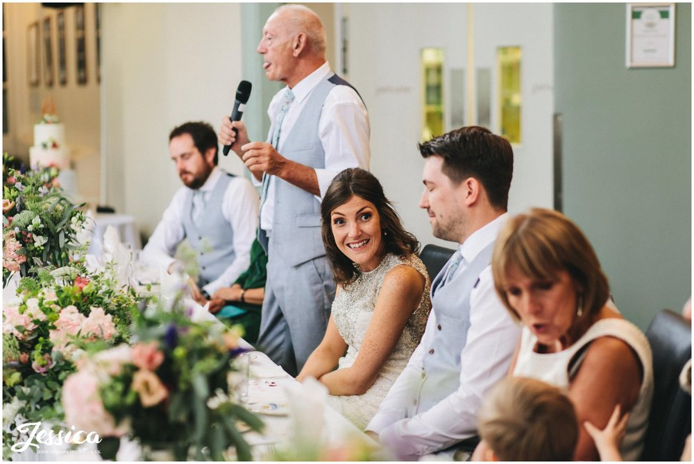 bride laughs during the father of the brides speech