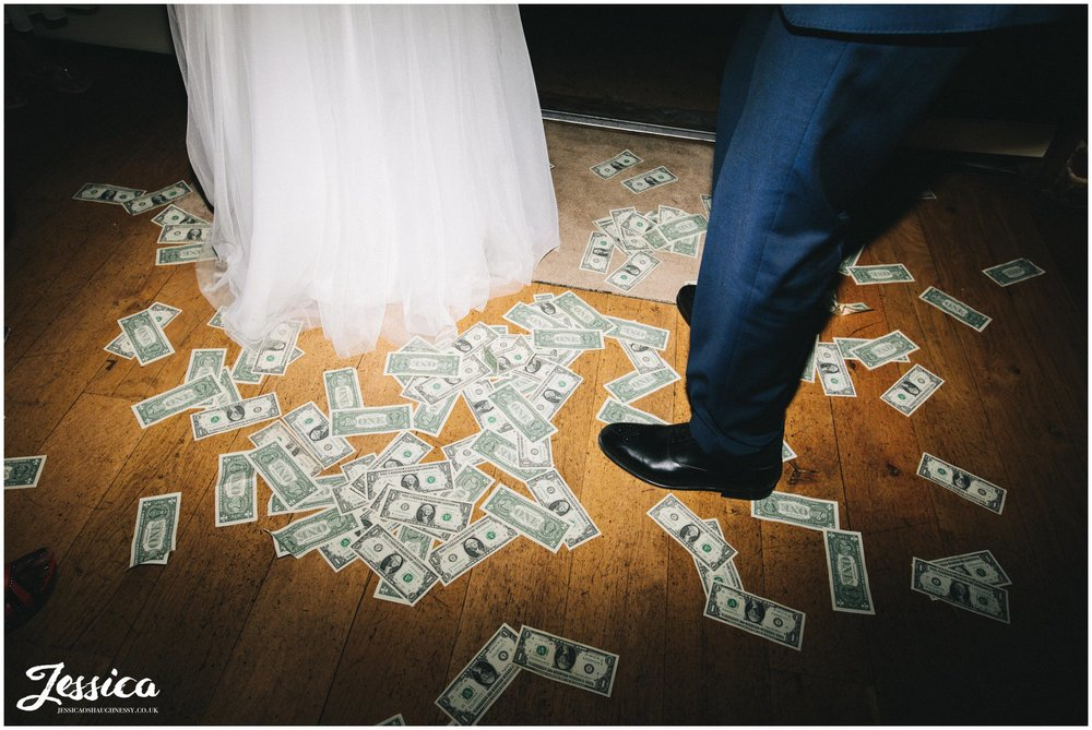 dollars cover the floor in a nigerian wedding tradition