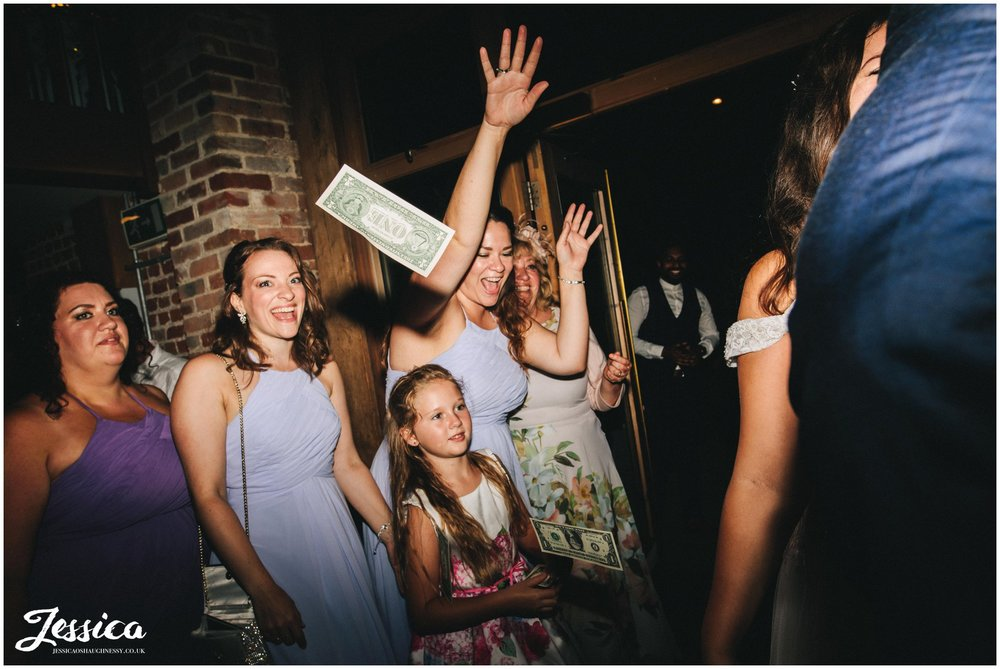 the bridesmaids throw dollars at gaynes park