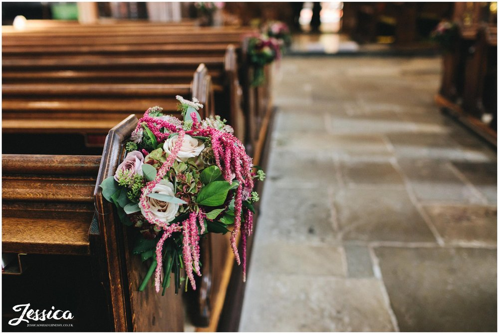Floral bouquets decorate the church