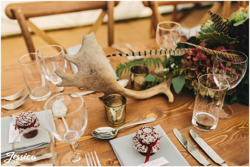 antlers & flowers decorate the tables