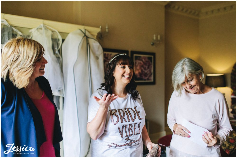 the bride wears bride vibes t-shirt on her wedding morning