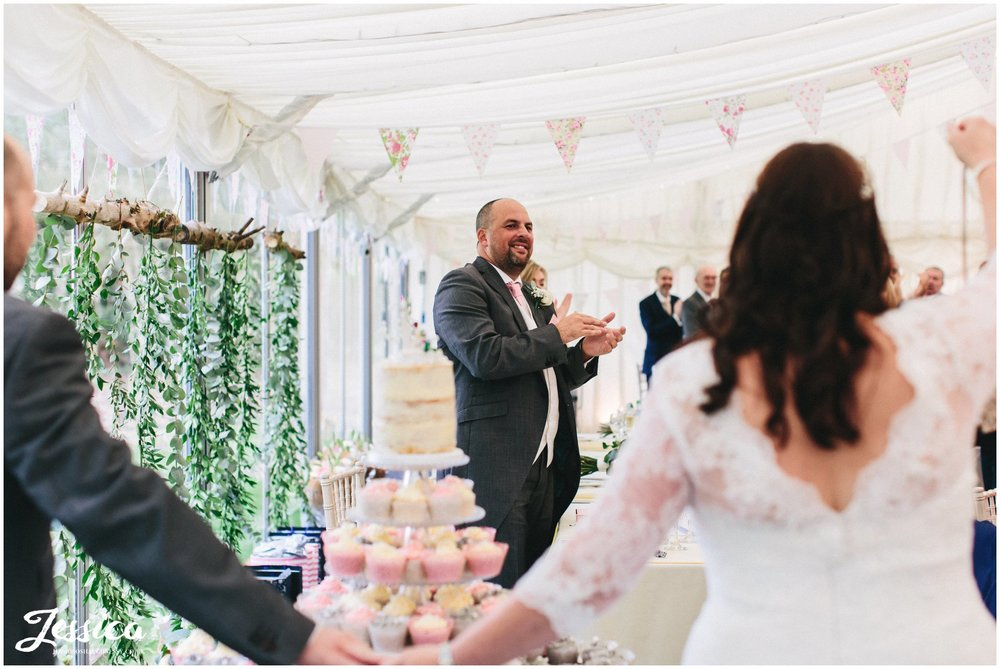 best man applauds the couple entering