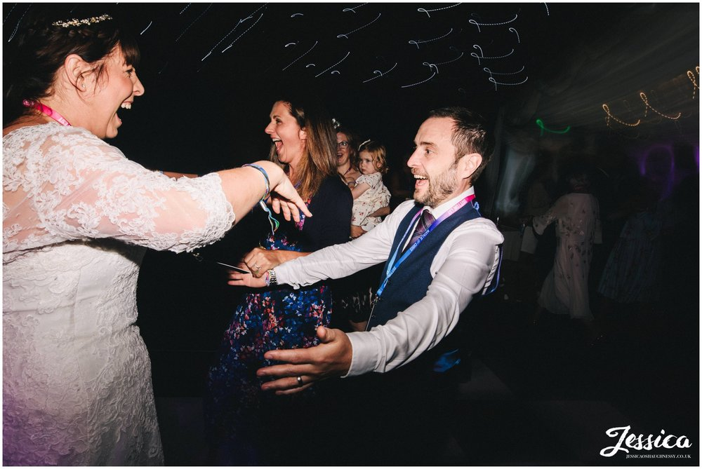 guests run on to dancefloor to join the couple