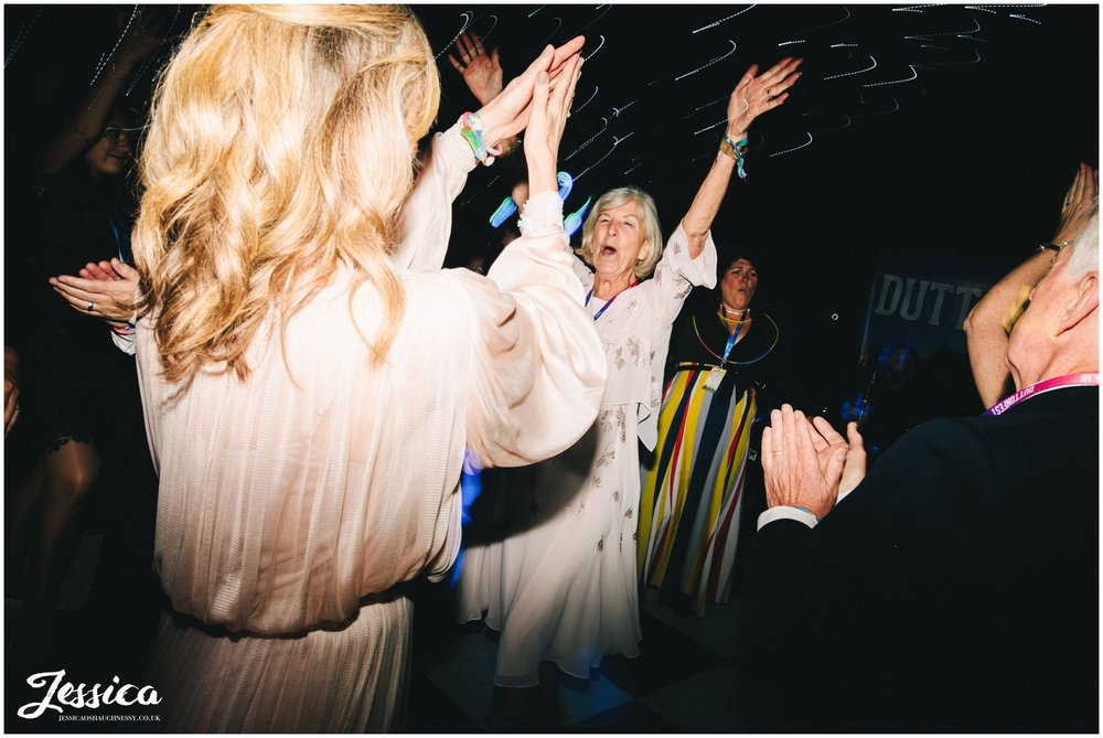 mother of the bride dances at the nunsmere hall wedding reception