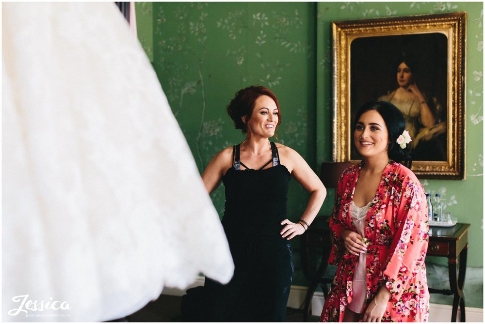 bridesmaids admire the wedding dress at stubton hall