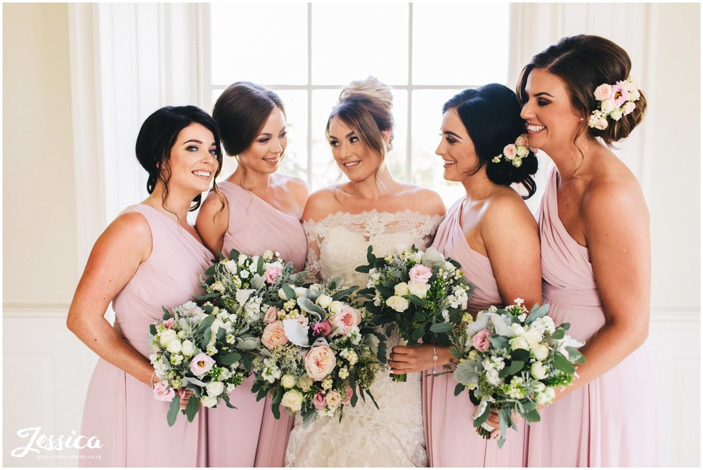the bride & her bridesmaids in the music room