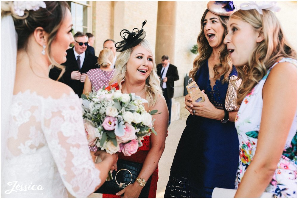 the brides friends laugh with her