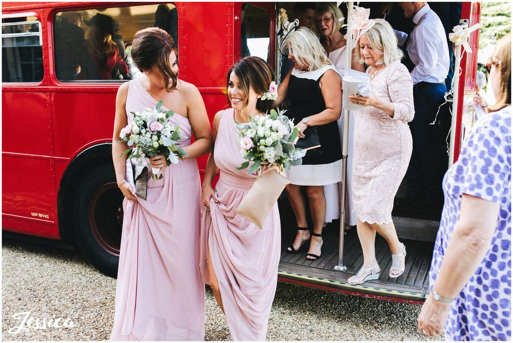 guests pile off the red bus back at the newark wedding venue