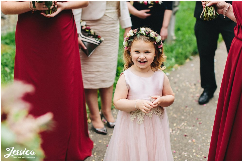 flower girl stood outside the church
