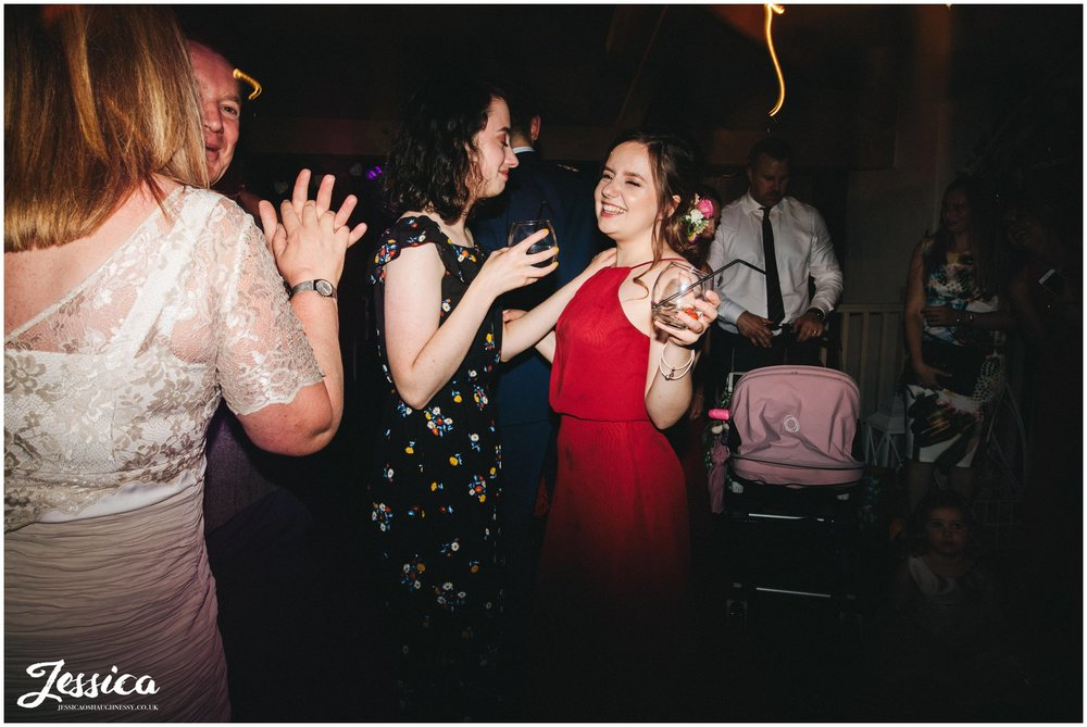 guests join the couple on the dancefloor at Llanrhaeadr Springs