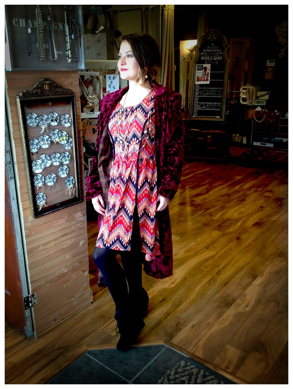 Here's Cassie showing off some of our new inventory! The dress and coat are both here at Better Together Boutique - but they won't be for long!