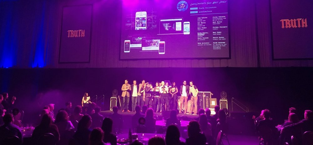 The Truth Collective team together onstage at Rochester's 2017 American Advertising Awards accepting its back-to-back Best In Show.