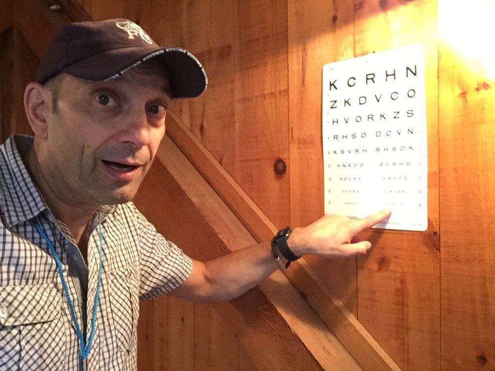 Stationed as the campers' first point of contact, John and the gang initiated a simple eye examination to assess vision and focus.