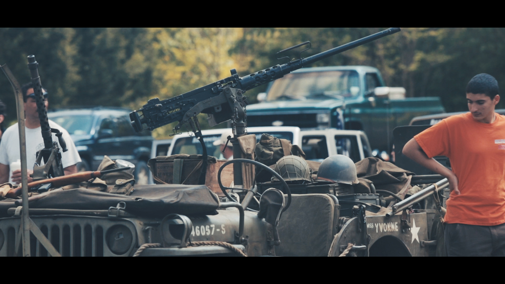 An old Jeep from the forties outfitted for fake war.