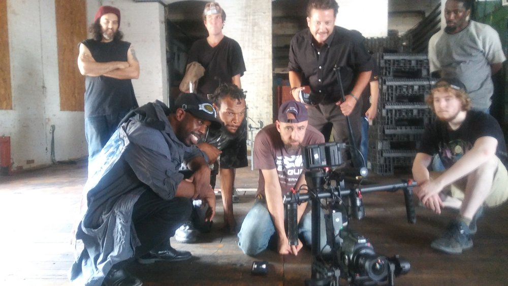 That's Tim in a squat on the left checking the shot. He's smiling. Always keep your client smiling. *Notice I am not smiling