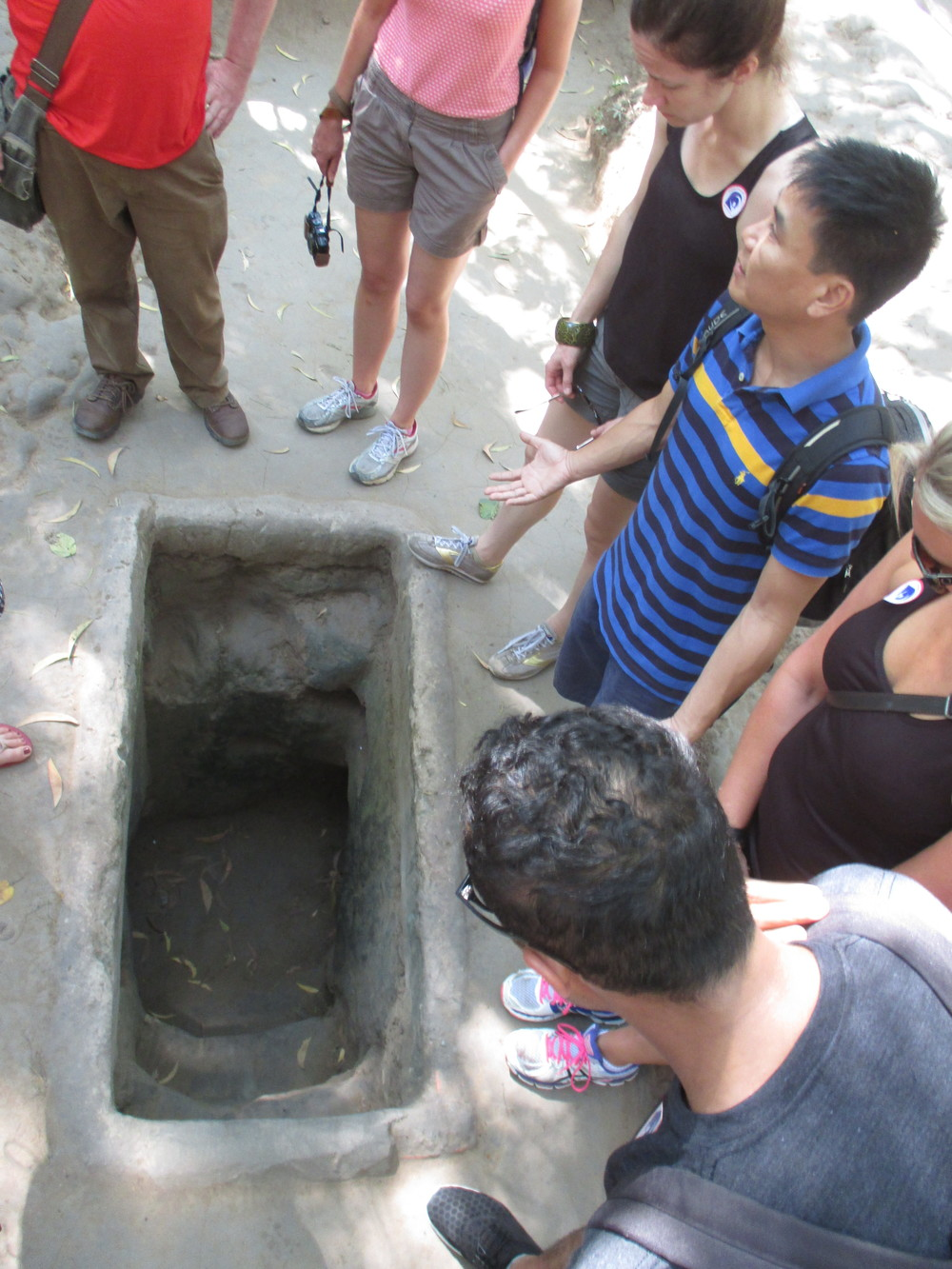 Hoang showing us an entrance to the tunnels