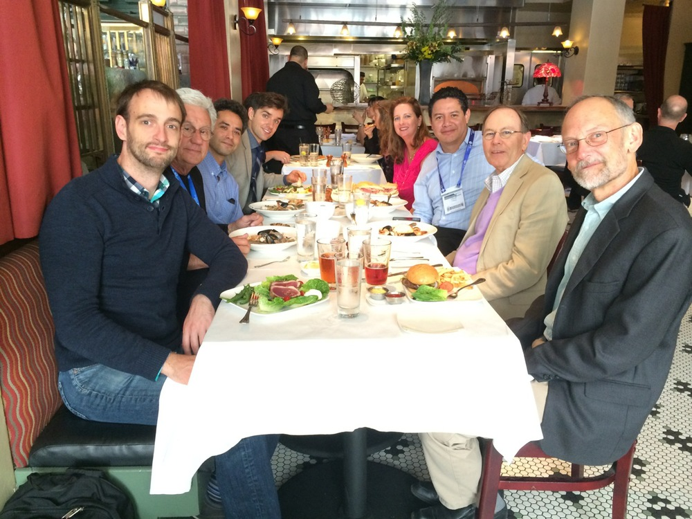 """Some of the top figures in cooking science at lunch following the Symposium """"Trends in Cooking Science"""", organized by Dr. Crosby, and held on 10 August 2014 at San Francisco, CA. Starting on the left front and moving around the table clockwise are: Jeff Potter, Terry Acree, Christopher Loss, Ali Bouzari, Kathryn Deibler, Cesar Vega, Guy Crosby, and Harold McGee."""