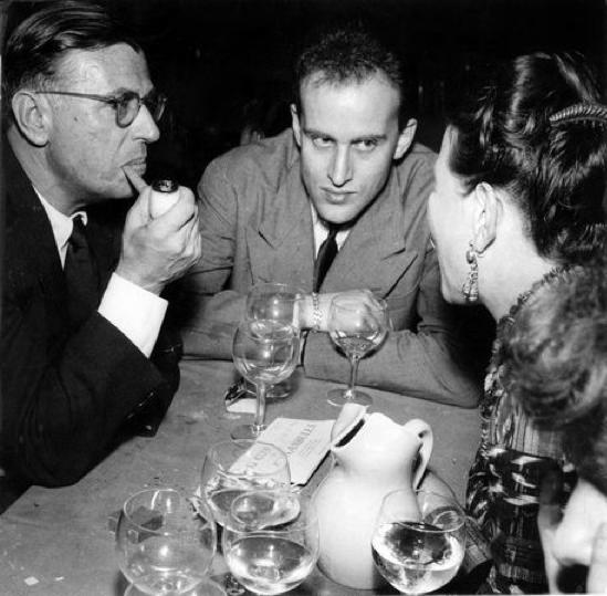 Jean-Paul Sartre, Boris Vian and Simone de Beauvoir in the café Le Procope, 1949.  By   Georges Dudognon .