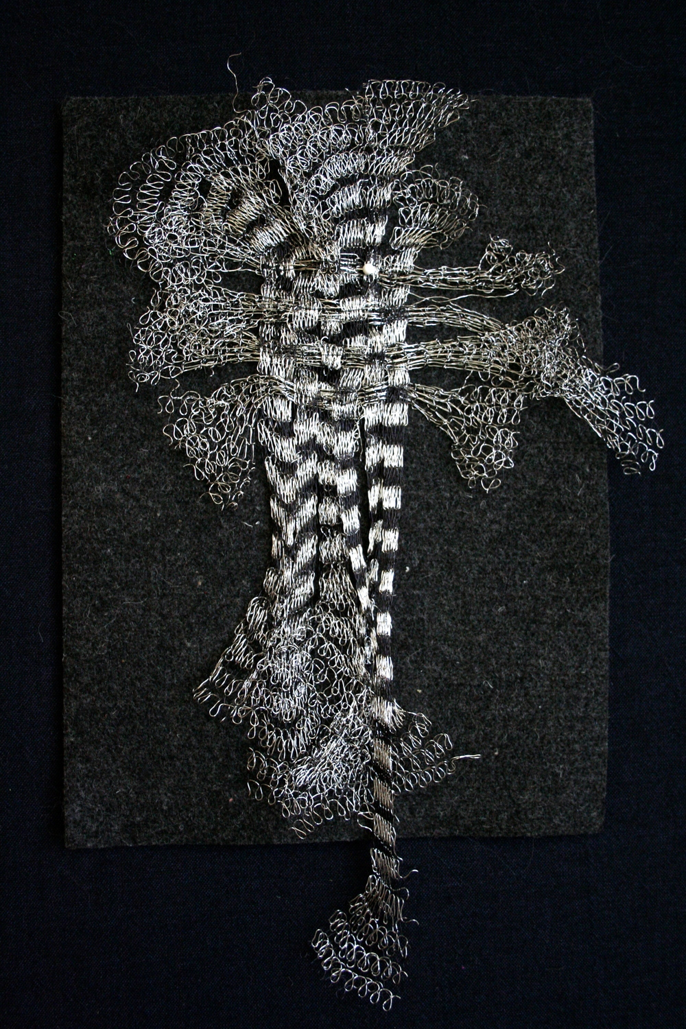 Stretched and woven wire knit