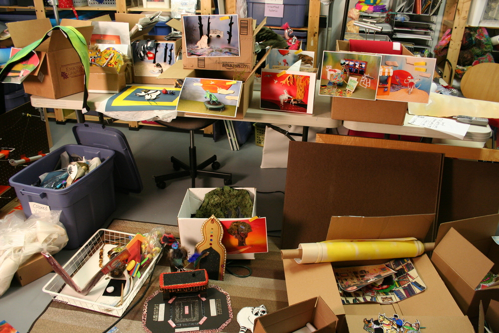 Each character and their set materials were loaded into boxes in a systematic fashion, having been photographically documented so they could be easily replicated. Backdrops were rolled onto several large cardboard tubes. It completely filled my car!