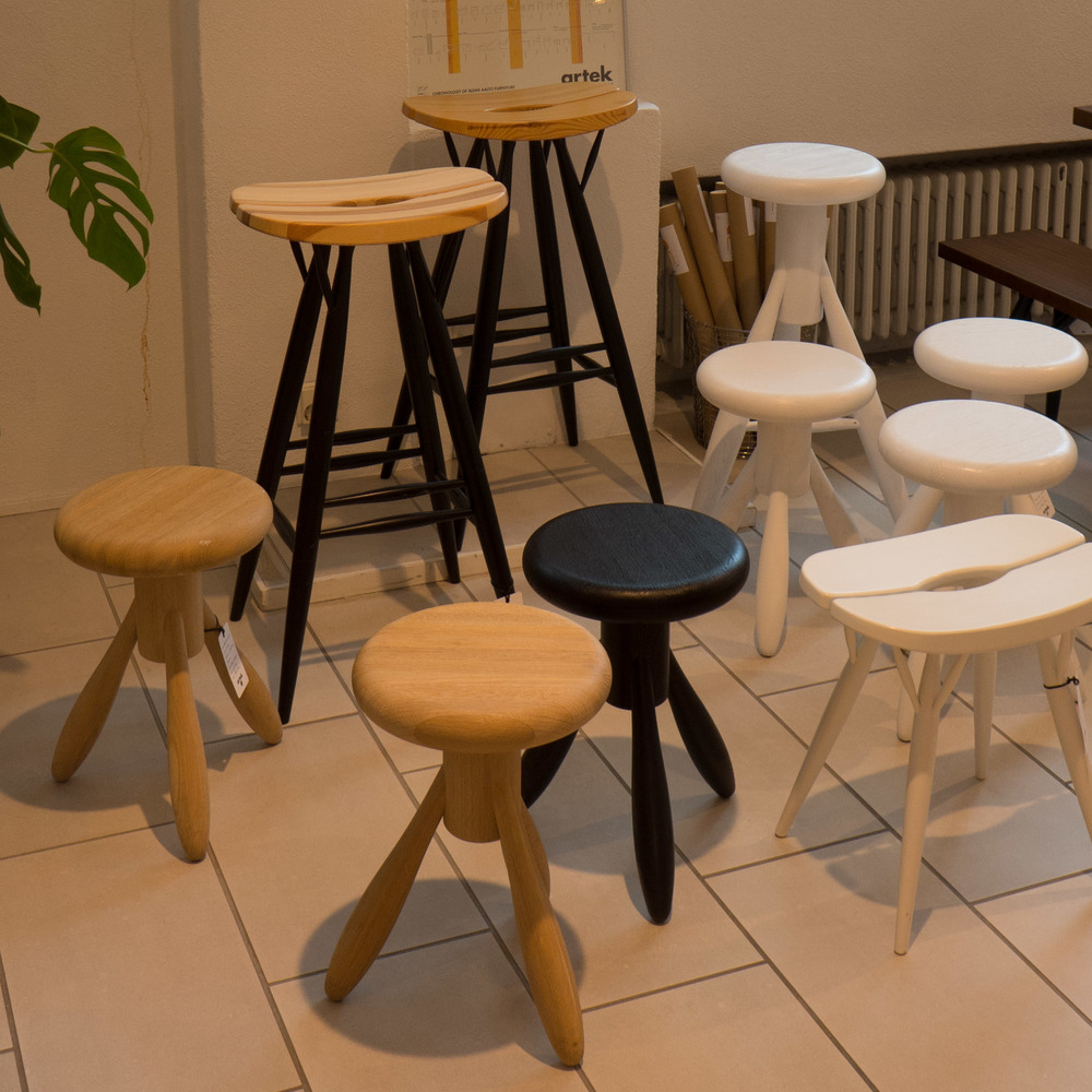 Pirkka Stools by Ilmari Tapiovaara designed in 1955 and the Rocket Stool by Eero Aarnio from 1995 in the Helsinki store