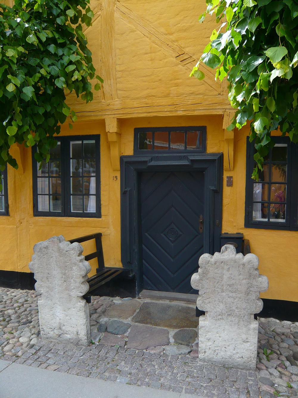 Striking colour in Køge - note the benches with ornate stone ends that flank the doorway