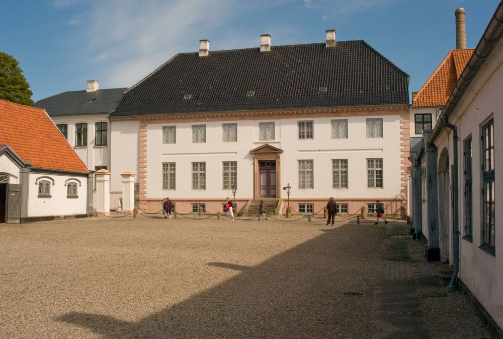 The house from the south with the stables and carriage houses flanking the forecourt