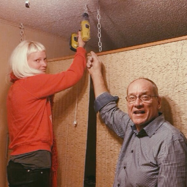 My dad and I posing with the most recent project we did together, hanging dividers in my apartment. My face is silly because I'm holding the drill up to a project that is obviously already done, so it's clearly fake posing.  However, through this project I realized my dad knows more than I do about building things (as most dads do) and I probably got some of my interest and ability to make things from him. But my favorite thing about Dad is that he is not afraid of hard things. He says when he looks back on his life, he would regret it if he just let himself stick to what was comfortable and safe. He'd rather fill it with adventure. (Like moving his family to Ukraine in 1999 to be a missionary, going on epic backpacking trips, and starting to run marathons for the first time in his 50's.) Though my dad and I have different methods of filling our lives with difficult and uncomfortable adventures, I think we both have the same desire to reach for things that we think are most worth having, though they are difficult to attain. We both would rather choose the extraordinary, though the cost may be painful. I'm proud to have a dad like that.
