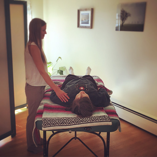 Kaitlin, practicing Reiki. (Photo by K. Clark)