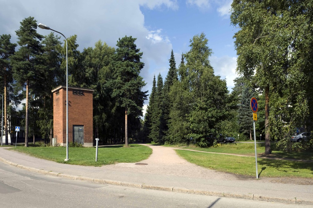 A desire path (right) merges with a footpath (center) in  Helsinki , Finland (Wikipedia)