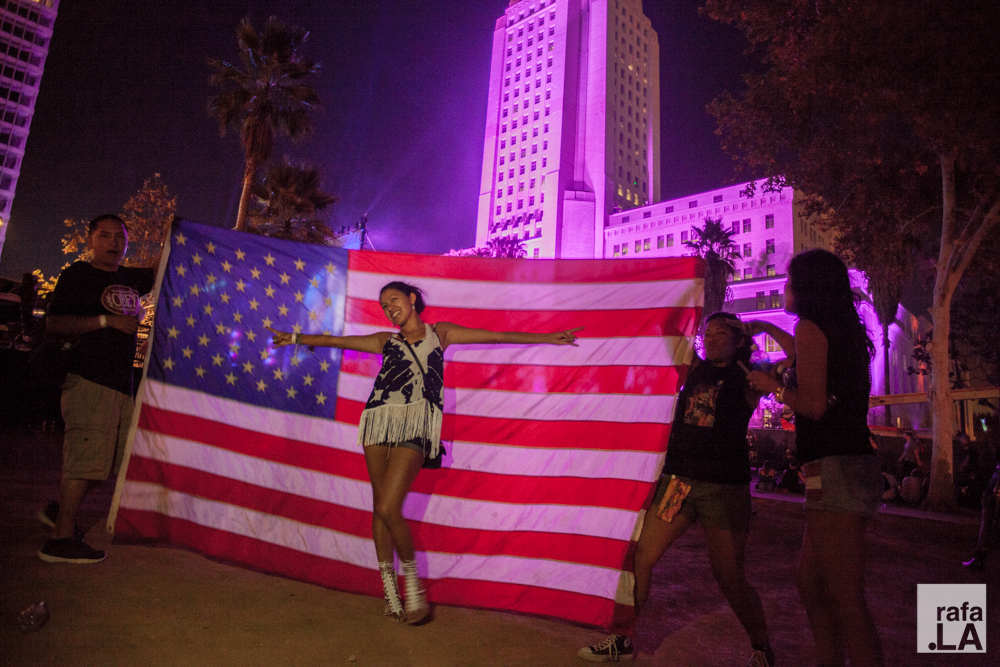 Festival goers flying their flag at the Made in America concert held on the steps of city hall and Grand Park.