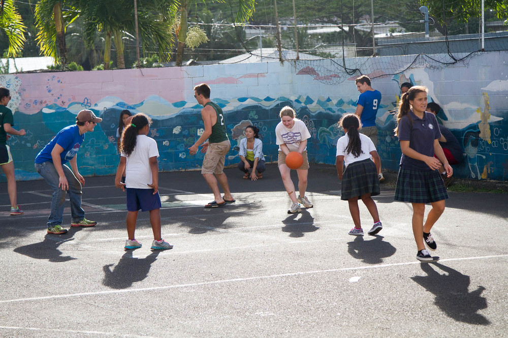 FCA is playing with Windward kids at their playground.